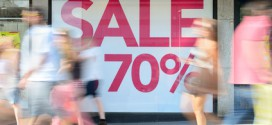 Shop sale sign, motion blurred pedestrians