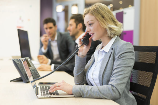 Businesswoman talking on the phone in modern office